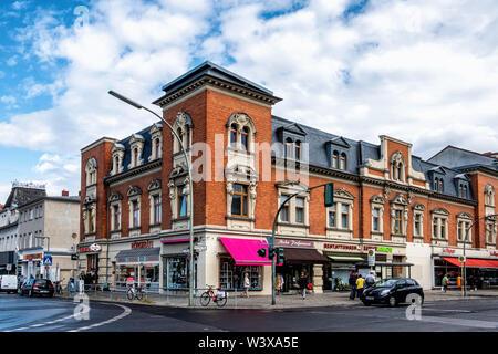 Historic red brick apartment & shop building on corner of Oberhofer Weg & Kranoldplatz in Lichterfelde-Berlin. Exterior & facade - Stock Image