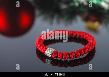 Broyanitsa, woven bracelet made of synthetic thread in which 33 knots and accessories in the form of beads and crosses inlaid with cubic zirconias. Ha - Stock Image