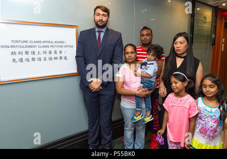 Hong Kong, Hong Kong, China. 25th June, 2018. Supporters and fellow Snowden refugees attend Ajith's torture claim appeal session along with Canadian refugee and human rights Barrister and solicitor Guillaume Cliche-Rivard (L).2nd left Nadeeka Dilrukshi Nonis holding her son Dinath(daughter Sethumdi R), rear, Supun Thilina Kellapatha and right, Vanessa mae Rodel with her daughter Keana in front (pink).Torture Claim Appeals board North Point Hong Kong Credit: Jayne Russell/ZUMA Wire/Alamy Live News - Stock Image