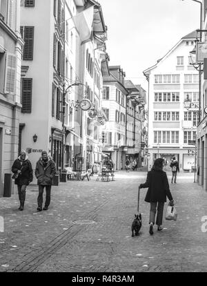 Walking the French bulldog through the Old Town of Lucerne, Switzerland. B&W - Stock Image