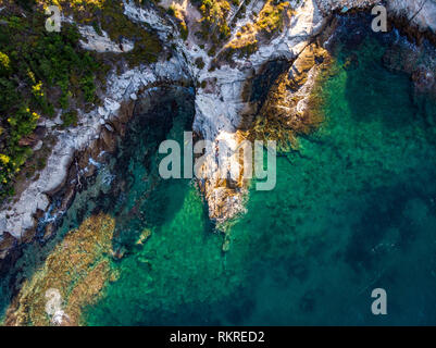 Aerial view of a cliffs and turquoise waters in Greece - Stock Image