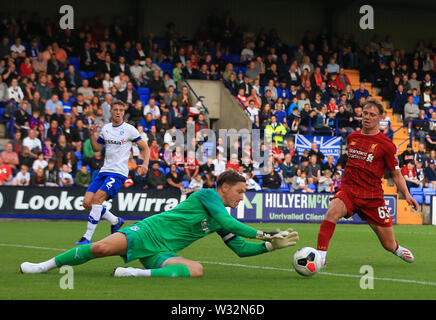 Prenton Park, Birkenhead, Wirral, UK. 11th July 2019. Pre-season friendly football, Tranmere versus Liverpool; Paul Glatzel of Liverpool chases the ball into the Tranmere six yard box but foiled by the keeper Credit: Action Plus Sports Images/Alamy Live News - Stock Image