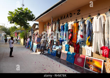 Maldive street scene with tourist shop - Rasdhoo island, Rasdhoo atoll, the Maldives, Asia - Stock Image