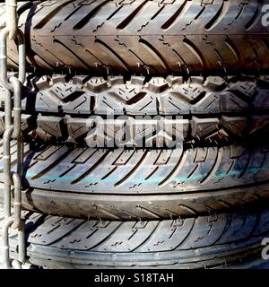 Stack of bike tyres - Stock Image