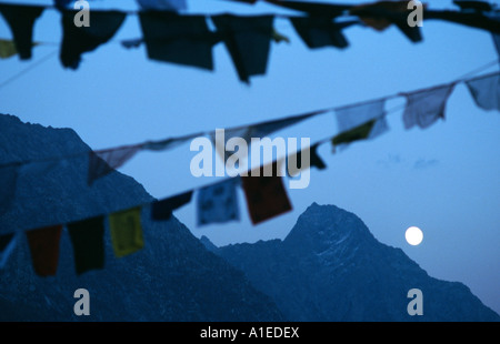 Tibetan prayer flags fluttering over a peak in the Indian Himalayas - Stock Image