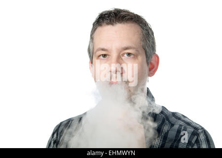 picture of a man exhaling smoke - Stock Image
