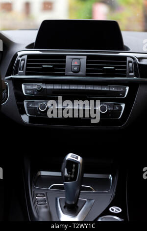 The black interior of a good modern car with navigator. - Stock Image
