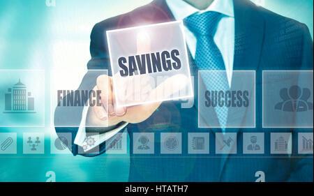 Businessman pressing an Savings concept button. - Stock Image