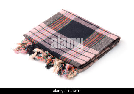 Folded plaid cloth with tassels isolated on white - Stock Image