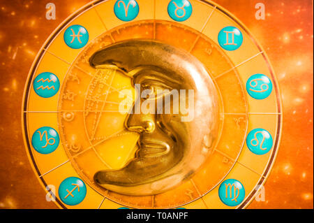 astrology wheel and moon shaped decoration - Stock Image