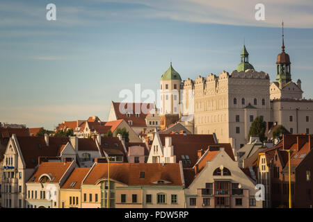 White castle with towers and green roofs and red roofs of residential and office houses in Szczecin, Poland - Stock Image