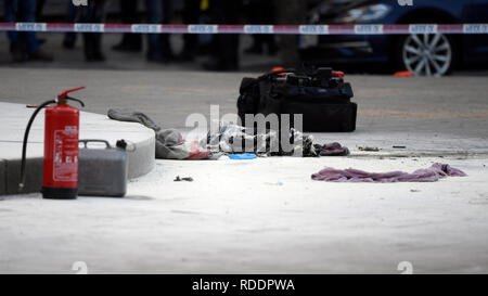 Prague, Czech Republic. 18th Sep, 2019. Burnt clothes is seen on the scene of the accident at upper part of Wenceslas Square in Prague, Czech Republic, where a man, born in 1964, poured combustible on him and set himself on fire on Friday, Jan. 18, 2019. The passers-by managed to put out the fire, his face and hands are burnt. Police inspect the incident. The paramedics told the media that the man suffered burns on 30 percent of his body. He was induced in artificial sleep and hospitalised. Credit: Ondrej Deml/CTK Photo/Alamy Live News - Stock Image