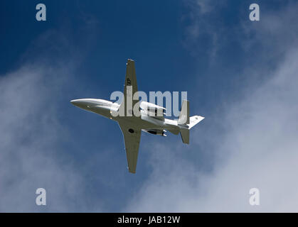 Citation Excel 560 aircraft climbing out from Inverness Dalcross airport in the Scottish Highlands. - Stock Image