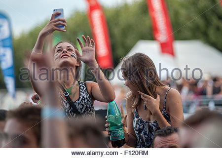 Selfie mania during concerts - Stock Image