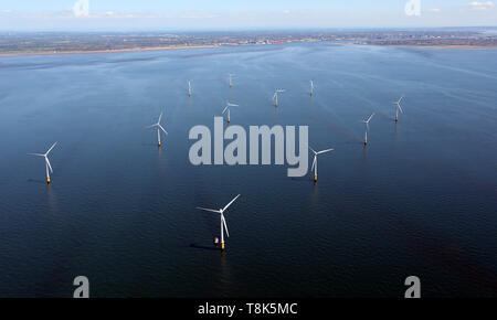 aerial view of a wind farm in the Irish Sea with Liverpool skyline in the distance - Stock Image