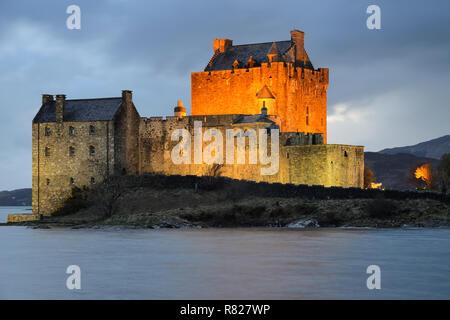 Eilean Donan Castle at dusk on the shore of Loch Duich near Dornie in Wester Ross, Highland Region, Scotland - Stock Image