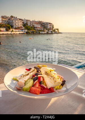 Greek Salad served at a taverna in Skala Marion traditional greek town in Thasos, Greece - Stock Image