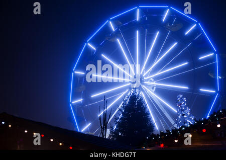 Ferris wheel illuminated at night at Christmastime - Stock Image