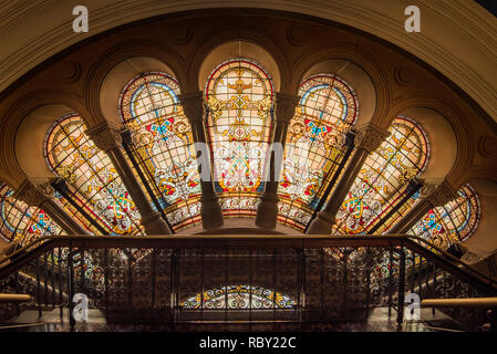 An interior view of stained glass windows on the Western side of the Queen Victoria Building, known locally as simply the QVB, in Sydney Australia - Stock Image