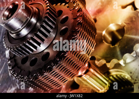 gears and cogs powered by large timing chain - Stock Image
