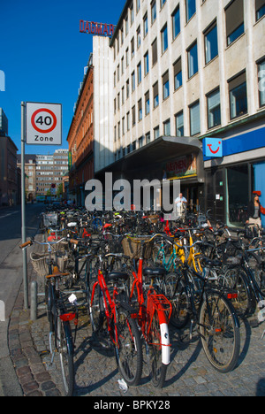 Parked bicycles central Copenhagen Denmark Europe - Stock Image