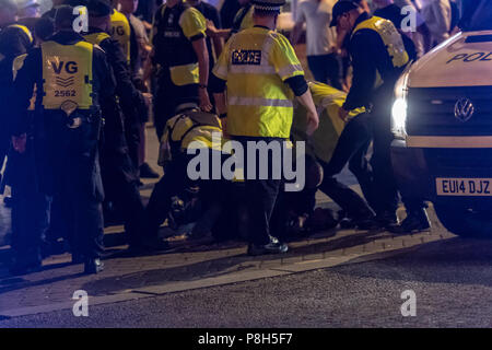 Brentwood Essex11th June 2018 Approximately fifty police officers deployed in Brentwood Essex  following England losing against Croatia.  Fans tears turned to disorder and Essex police had to clear fans down the entire length of the High Street.  One small group of fans challenged the police and arrests were made. Credit Ian Davidson/Alamy Live News - Stock Image