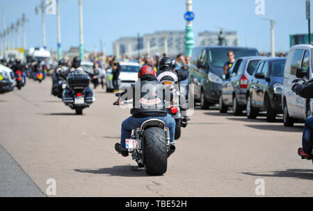 Brighton UK 1st June 2019 - Hundreds of Hells Angels arrive along Brighton's Madeira Drive on the seafront as part of their 50th anniversary celebration weekend . Over 3000 bikers from  rround the world have gathered in Surrey before heading down towards Brighton today where a heavy police presence was keeping an eye on them . Credit : Simon Dack / Alamy Live News - Stock Image