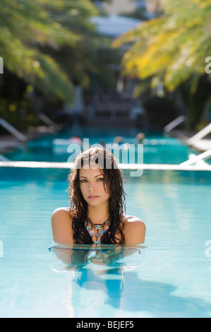 Portrait of a young woman in a swimming pool - Stock Image