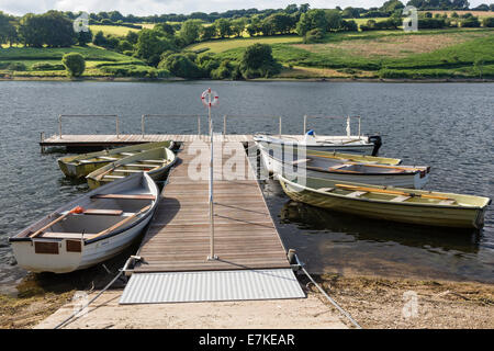 Rowing boats tied to landing stage on Clatworthy reservoir. - Stock Image