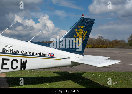 Tail of light aircraft in the livery of the British Caledonian airline 30 years after the takeover by British Airways, Blackbushe Airport, UK - Stock Image