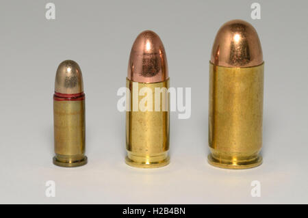 Row of pistol ammunition, different calibers - Stock Image
