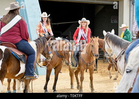Miss Rodeo Florida, Cara Spirazza, and Miss Rodeo Tennessee, Olivia Johnston on horseback at the SLE rodeo in Montgomery Alabama, USA. - Stock Image