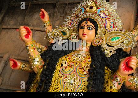 Colorful and nicely decorated Durga statue in Kumartuli, Kolkata, India - Stock Image