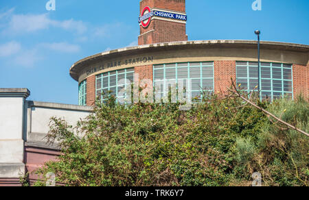 Part of outside of Chiswick Park Underground Station, a Grade II listed building which serves the District Line in Chiswick, West London, England, UK. - Stock Image