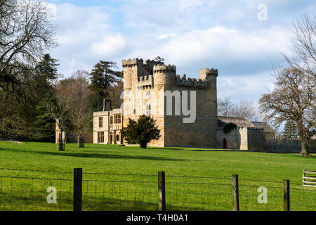 Belsay Castle, a 14th century peel tower, and later domestic buildings, in Northumberland, England, UK - Stock Image