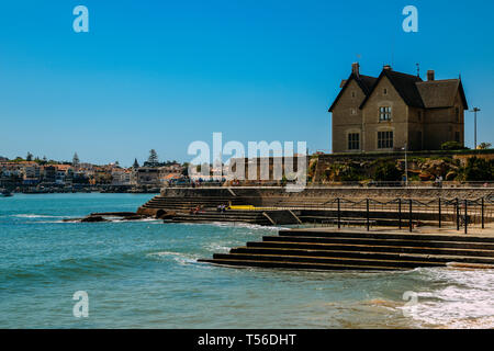 Cascais, Portugal - April 21st, 2019: Families relax at the Oceanic Pool Alberto Romano in Cascais - Stock Image