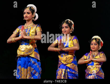 Horizontal view of beautiful Bharatanatyam dancers performing during Pongal festivities in India. - Stock Image