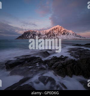 Waves was over tidal rocks at Skagsanden beach, Flakstadøy, Lofoten Islands, Norway - Stock Image