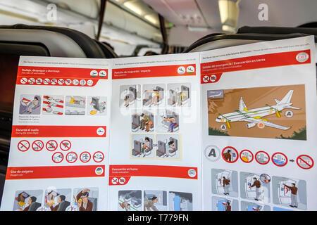 Miami Florida Miami International Airport MIA onboard cabin Avianca Airlines flight AV 35 Aircraft safety card emergency procedures illustration - Stock Image