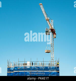 Gosford, New South Wales, Australia - Nov 16. 2018: Construction and building progress update 120.  A working tower crane on new home units building - Stock Image