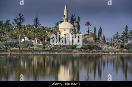 Hala-Sultan-Tekke Mosque at the salt lake, Larnaka, Cyprus - Stock Image