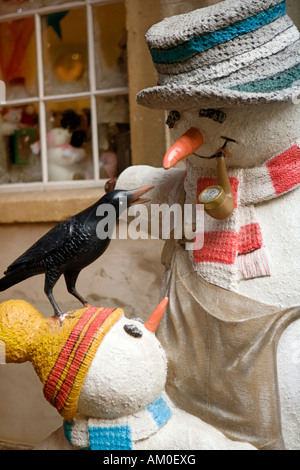 Snowmen at Wookey Hole Caves Wells England - Stock Image