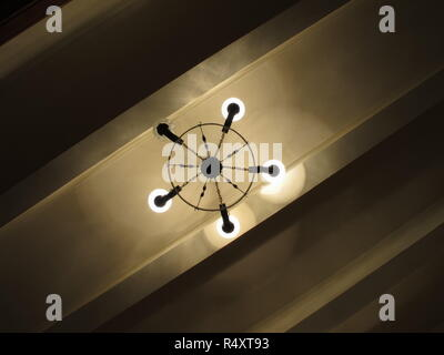 Ceiling chandelier with one lamp not working - Stock Image