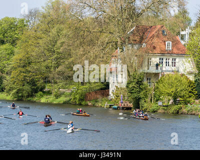 Rowing clubs celebrate the start of the rowing season, all kinds of boats  active, rowing on river Aller, center - Stock Image