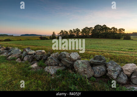 A stone wall and field at the Cox Reservation in Essex, Massachusetts. - Stock Image
