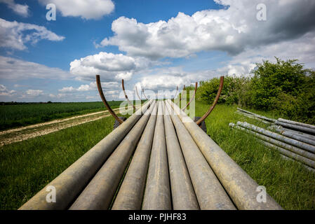 France, Southwestern France, Saint Savinien, irrigation pipes in a field - Stock Image