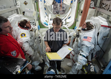 Commercial Crew Program astronauts Nicole Mann, left, Boeing Astronaut Chris Ferguson, center, and Mike Fincke, right, train inside the ISS EVA PrepPost 1 training simulator for future spacewalks while onboard the International Space Station at the Johnson Space Center February 6, 2019 in Houston, Texas. - Stock Image