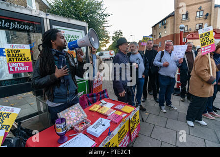 London, UK. October 9th 2018. A rally begins outside the New Atlas Cafe Restaurant where a young black man was attacked by police who used obviously unnecessary force when arresting him on suspicion of having been involved in a knife attack. He was assaulted by six officers, and was viciously kicked while officers struggled to handcuff him, andwhen he was well under control and held on the ground he was sprayed in the face with CS gas. Credit: Peter Marshall/Alamy Live News - Stock Image
