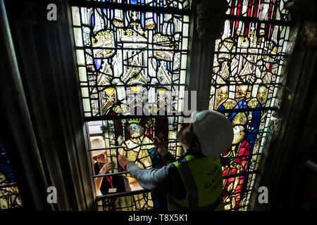Conservation Manager Nick Teed removes a stained glass window during the first phase of work to protect 600-year-old stained glass windows, part of an 11 year, ??11m conservation and restoration project at York Minster. - Stock Image