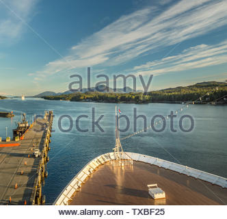 Sept 17, 2018 - Ketchikan, AK: Elevated view of emptying dock, Tongass Channel and cruise ship bow at end of day in sunset light. - Stock Image